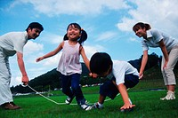 Family playing with jump rope