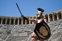 Turkey, Antalya, Aspendos, the Roman Theater, an actor playing as a gladiator