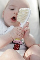 Baby playing with brush