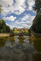 Clouds and Statues reflected in the fountain of Waddeston Manor built for Baron Ferdinand de Rothschild and designed by Gabriel_Hippolyte Destailleur....