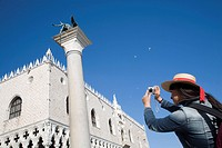 Italy, Venice. Woman photographing Doge´s Palace