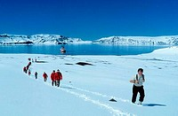 ANTARCTICA, DECEPTION ISLAND, TOURISTS HIKING UP THE SLOPE OF CRATER