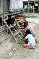 INDONESIA, SUMATRA, LINGGA, KARO BATAK VILLAGE, LOCAL BOYS MAKING BROOMS