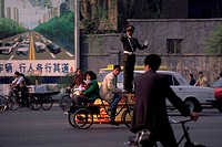 CHINA, BEIJING, STREET SCENE, POLICEMAN DIRECTING TRAFFIC