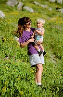 Mother and son standing in meadow in the Wasatch mountains near Alta in Utah, USA