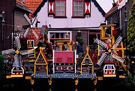 NETHERLANDS, VOLENDAM, LOCAL HOUSE WITH MODEL WINDMILLS KITSCH