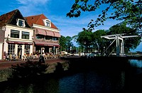 NETHERLANDS, HOLLAND, HOORN, CANAL SCENE WITH DRAWBRIDGE AND SIDEWALK CAFE