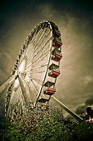 The Ferris Wheel lit up at dusk at Navy Pier in Chicago, Illinois.Storm clouds are in the background