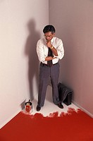 Businessman painting himself into a corner