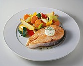 Salmon steak with vegetables and herb butter