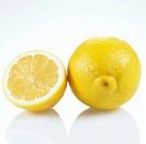 Half and Whole Lemon on White Background