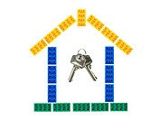 A house assembled from toy building blocks with a set of keys