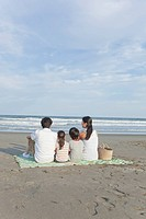 Family Sitting at Beach