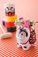 Papier_mch dog and Daruma doll game