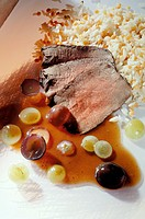 Fillet of ostrich in grape sauce with rice