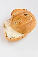 Buttered bread roll with nuts