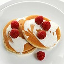 Pancakes with cream and fresh raspberries