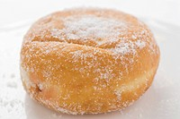 A sugared doughnut filled with jam