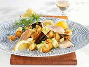 Fried potatoes with cucumber and smoked fish