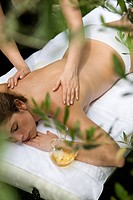 Woman getting olive oil massage