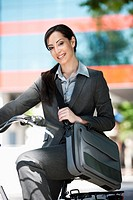 Woman in suit on bicycle
