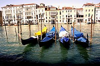 Gondoals tethered to posts before a storm, Venice, Italy