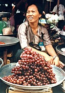 Vietnam, woman selling grapes