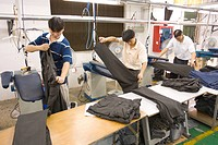 SHENZHEN, GUANGDONG PROVINCE, CHINA _ Workers ironing finished clothing, in garment factory in city of Shenzhen, one of mainland China´s first Special...