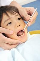 Boy undergoing dental examination
