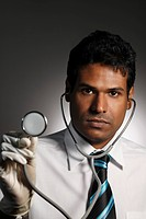 head shot of doctor holding stethoscope