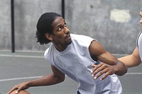 View of young man playing basketball.