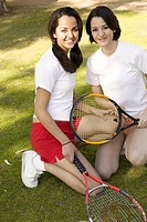 View of two friends holding rackets.
