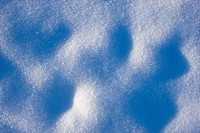 Close up of the winter sun highlighting texture in the snow, Noatak, Arctic Alaska, Winter