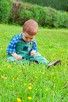boy sits on herb.