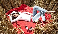 A girl sleeps in the cornfield
