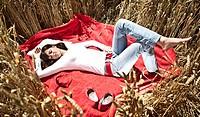 A girl sleeps in the cornfield
