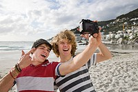 Teenage boys photographing themselves