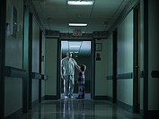 Male nurse and young boy in hospital corridor
