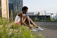 Runner sitting on sidewalk (thumbnail)