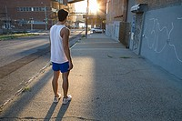 Male runner on urban street