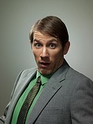 Surprised mid adult businessman, portrait