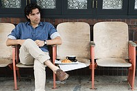 Man sitting outside coffee shop