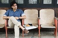 Man sitting outside coffee shop