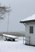 Sailboat ashore in wintery scene
