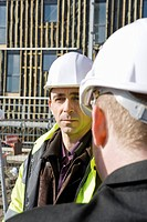 Building contractor having conversation with site foreman