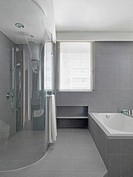 Large glass shower in modern gray bathroom