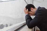 Man contemplating after a days work