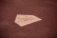 Close up of home base on a baseball field.