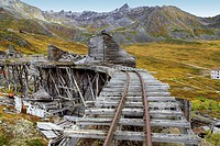 Remains of old mine buildings with Talkeetna Mountains in background.