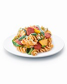 Pasta with sausage amd vegetable ribbons.